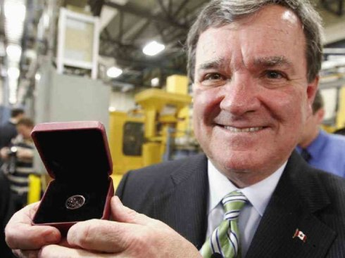 Finance Minister Jim Flaherty shows the last penny produced in Canada. (Keep an eye on Ebay).
